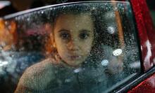 Little Girl In The Rain Inside...