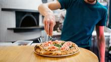 Preparing Pizza In A Restaurant