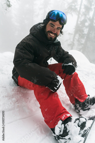 Man on the snowboard into the wild