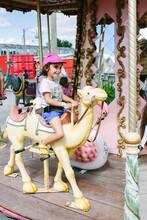 Kid On Carrousel