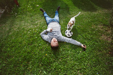 A Man Lying On The Grass With ...