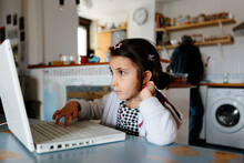 Kid Using A Laptop At Home