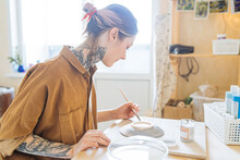 Cute Tattooed Girl Paints A Pl...