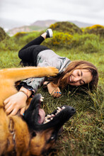 Laughing Woman With Dog On Gre...