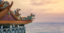 Beautiful Temple Overlooking Coast At Sunset. Chinese Dragon Statue On The Roof.