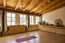 Yoga Mat Placed On Wooden Floo...