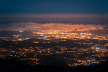 Aerial View Of Breathtaking Scenery Of Gran Canaria City With Glowing Lights Under Cloudy Sky In Evening