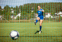 Female Athlete Shooting Ball I...