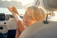 Blonde Girl Sitting In A Car W...