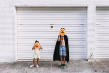 Boy And Girl Covering Faces Wi...