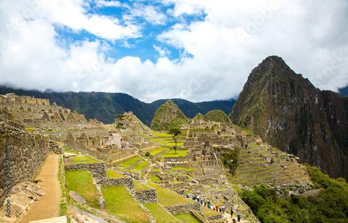 Fotografering View of a tour group visiting Macchu Picchu, Peru.