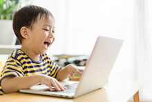 Asian Toddler Boy Student Study Online Learning Online Education Video Call Zoom Teacher.Happy Boy Learn English Online With Laptop At Home.New Normal.Covid-19 Coronavirus.Social Distancing.stay Home.