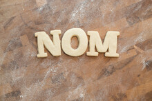 """Shortbread Cookie Letters Spelling Out The Word """"""""nom"""""""""""
