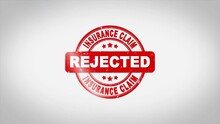 Insurance Claim Rejected Signed Stamping Text Wooden Stamp Animation. Red Ink On Clean White Paper Surface Background With Green Matte Background Included.