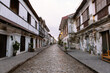 Photo of an empty historic old street early in the morning.
