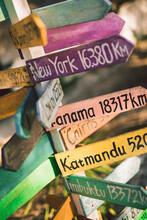 Travel Destinations On Crossroad Sign