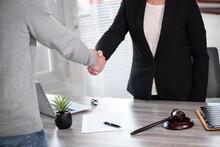 Handshake Between Female Lawye...
