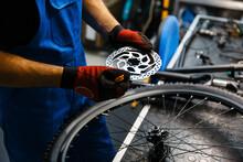 Bicycle Repair In Workshop, Man Fixing Brake Disk