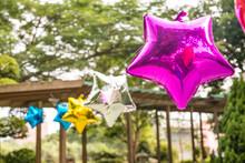 Star Shape Balloon Hanging In Anniversary Fair