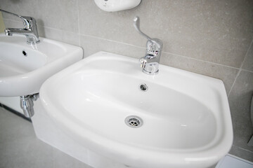 Clean faucet with sink in a public place
