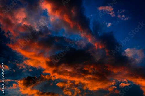 Beautiful sunset. Red clouds in the dark sky
