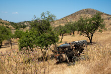 Farm Tractor Lay Into The Rural Field With Trees After Accident