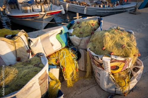 Canvastavla Fishing nets ropes and floats. Fishnet on a basket