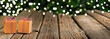 Christmas banner, gifts on wooden table