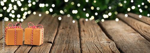 Fototapeta Christmas banner, gifts on wooden table obraz