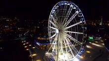 Aerial Drone Flight At Night Around The Ferrsi Wheel Of Liverpool, England, Near The Albert Dock