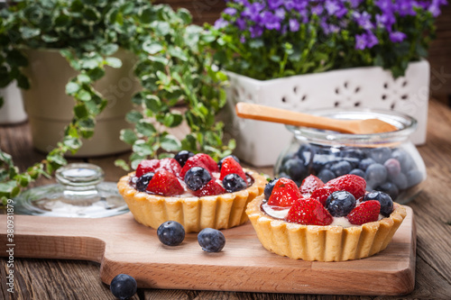 Fresh homemade fruit tart with strawberries and blueberries.