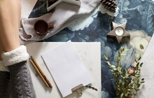 Flat Lay Image Of Writing To Do List With Espresso And Pine Cones