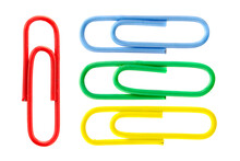Collection Of Colorful Paper Clips Isolated On White Background, Top View. Colored Paper Clips On A White Background, Top View. Five Colored Paper Clips Isolated On A White Background.