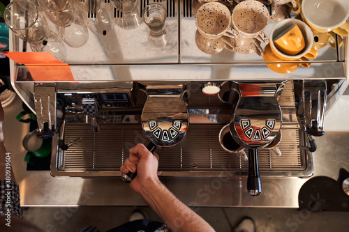 Obraz na plátně Barista preparing cappuccino for customer