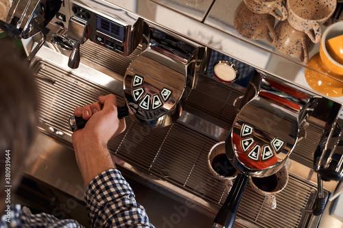 Fotografie, Obraz Professional bartender preparing espresso