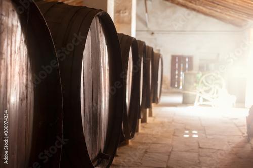 Cuadros en Lienzo Wine barrels stacked in the old cellar of the vinery in Spain
