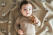 Newborn Toddler Boy In Beige B...