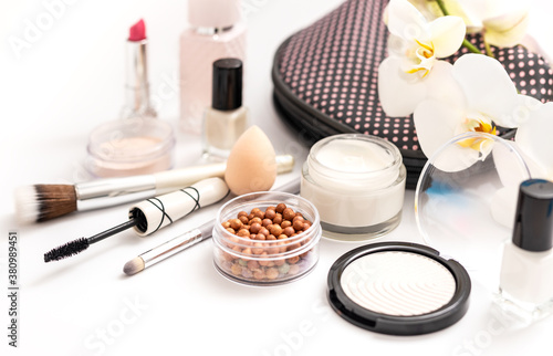 Fototapeta Beauty background with facial cosmetic products. Makeup, skin care concept. obraz