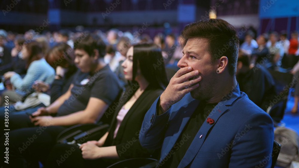Fototapeta Person yawn at business meet boring lecture speaker. Crowded audience asleep. Expressive face sleeping business man on forum. People emotion yawning at conference. Auditorium sleep tired from insomnia