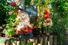 Cheerful Garden Gnomes With Inscription WELCOME. 24 September 2020, Minsk Belarus