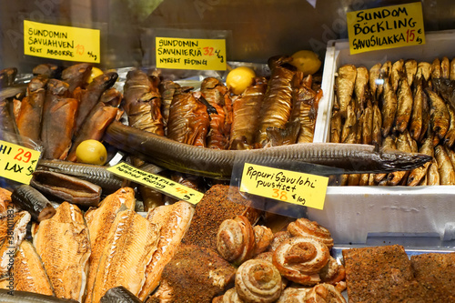 Fototapeta Assorted scandinavian smoked fishes and delicacies at counter