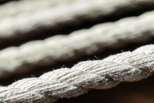 Close-up Macro Image Of A Fraying Rope On A Hammock With Ropes In The Background; Selective Focus