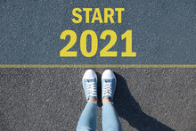 Text Start 2021 On Asphalt In Front Of Woman, Top View
