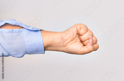 Fotografie, Obraz Hand of caucasian young woman doing punch sign showing fist over isolated white