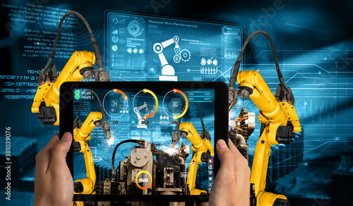 Engineer controls robotic arms by augmented reality industry technology application software Fototapeta