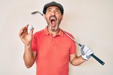 Middle Age Hispanic Man Holdin...