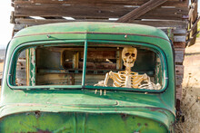 Skeleton Sitting Inside An Old...