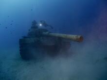Scuba Diver Exploring Tank Wre...