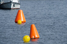 Orange Buoy On The Pond For The Safety Of Children