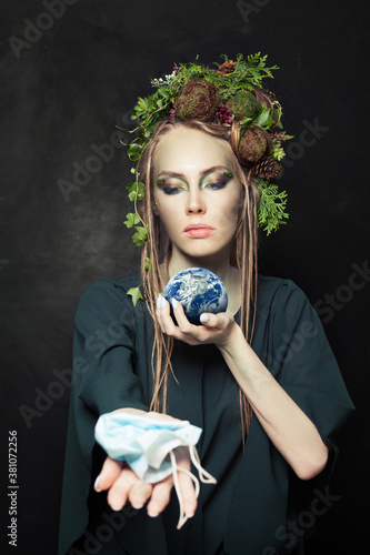 Fototapeta Environment protection concept. Woman during COVID-19 holding Earth this image furnished by NASA obraz
